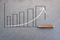Drawing of business bar chart with pencil Stock Photos