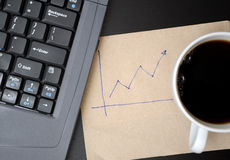 Drawing business finance graphs. In office Stock Images