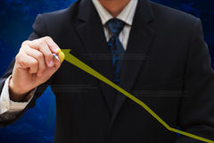Drawing business graph. Businessman hand drawing business graph royalty free stock photos