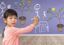Drawing of Business graphics on plant branches on wall and family sketches. Digital composite of Drawing of Business graphics on plant branches on wall and Stock Photos