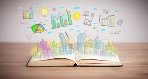 Drawing of a business scheme on an opened book Stock Images
