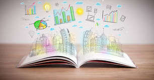 Drawing of a business scheme on an opened book. Drawing of a colorful business scheme on an opened book Stock Photos