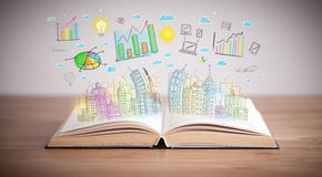 Drawing of a business scheme on an opened book. Drawing of a colorful business scheme on an opened book royalty free stock images