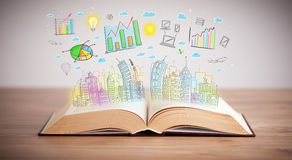 Drawing of a business scheme on an opened book. Drawing of a colorful business scheme on an opened book Royalty Free Stock Photo