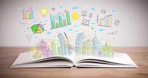 Drawing of a business scheme on an opened book Royalty Free Stock Photos