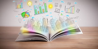 Drawing of a business scheme on an opened book. Drawing of a colorful business scheme on an opened book stock image