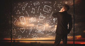 Drawing businessman with social media icon background Royalty Free Stock Photo