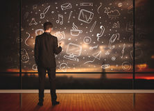 Drawing businessman with social media icon background Stock Image