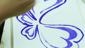 Drawing a butterfly stock video