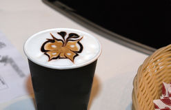 Drawing of a butterfly in a glass of coffee. Of a cappuccino stock photo
