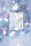 Drawing candle with blue bokeh backgrounds for christmas day. Royalty Free Stock Images