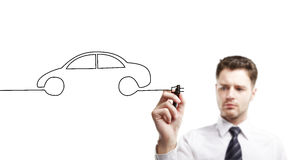 Drawing car. Young businessman drawing abstract car stock photo