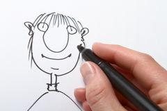 Drawing caricature Royalty Free Stock Images