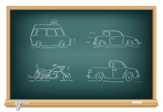 Drawing cars by a chalk Stock Images