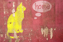 Drawing Cat homesick on cracked concrete. Vintage wall background royalty free stock photo
