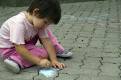 Drawing with Chalk Stock Image