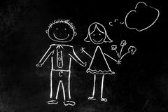 Drawing with chalk on black background boy and girl stock photo