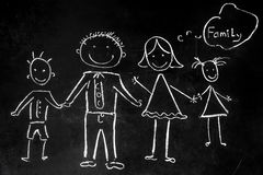 Drawing with chalk on the black background of the family stock photography