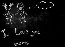 Drawing with chalk on a black background for a mother. The concept of friendship and happy family stock photography