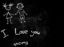 Drawing with chalk on a black background for a mother. The concept of friendship and happy family stock image