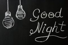 Drawing with chalk on a black background - wishing you a Good night with the painted light bulbs. royalty free stock image