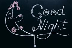 Drawing with chalk on a black background - wishing you a Good night with a picture of a sleeping moon.  Royalty Free Stock Photo