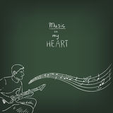 Drawing with chalk on a green chalkboard - male guitarist. Musical illustration. Stock Photo