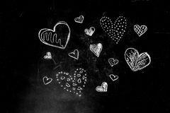 Drawing chalk hearts royalty free stock images