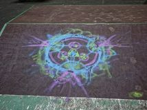 Drawing with chalk on the hill for a skateboard