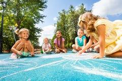 Drawing chalk image on playground Stock Image