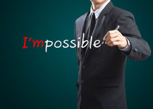 Drawing and changing the word impossible to i'm possible. Hand drawing and changing the word impossible to i'm possible Stock Photo