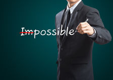 Drawing and changing the word impossible to i'm possible. Hand drawing and changing the word impossible to i'm possible Stock Photography