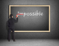 Drawing and changing the word impossible to i'm possible. Hand drawing and changing the word impossible to i'm possible Royalty Free Stock Photos
