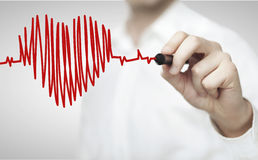 Drawing chart heartbeat. High resolution man drawing chart heartbeat Royalty Free Stock Images