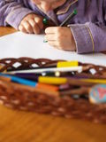Drawing child. A child fully engrossed in drawing her picture Stock Photo