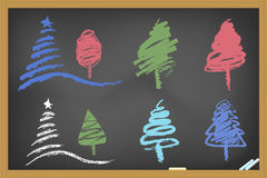 Drawing christmas tree on blackboard Stock Photos