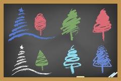 Drawing christmas tree on blackboard. For christmas design Stock Photos
