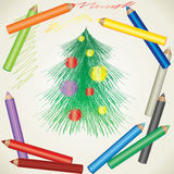 Drawing of Christmas tree and color pencils Royalty Free Stock Photography