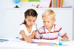 Drawing classmates Royalty Free Stock Photos