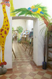 Drawing classroom entrance with painted colorful animals. Royalty Free Stock Photos