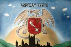 Drawing coat of arms Worms at Main. Worms, Germany - October 13, 2018: The drawing of the coat of arms of the city of Worms at Main at an electric house on stock photos