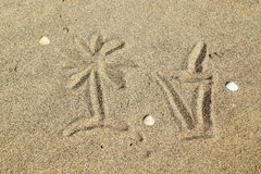 Drawing a coctail glass on sand. Drawing  a coctail glass on sand Royalty Free Stock Photo