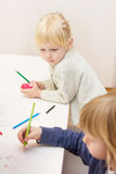 Drawing with colorful crayons Stock Photos