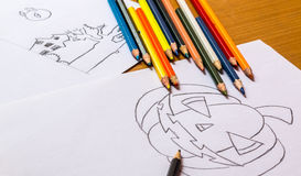Drawing. And coloring prepare a pumpkin for Halloween Royalty Free Stock Images
