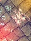 Drawing with colour chalk. Drawing with various colour chalk. A pink butterfly stock photo