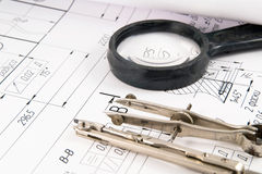 Drawing Compass. A closeup view of an architect's drafting table showing a blueprint and two compasses Royalty Free Stock Photos