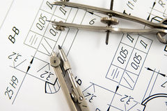 Drawing Compass. A closeup view of an architect's drafting table showing a blueprint and two compasses Royalty Free Stock Photography