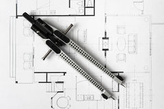Drawing Compass. On A House Blueprint Stock Photo