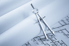 Drawing Compass on Blueprint Documents Royalty Free Stock Photo