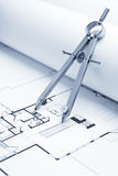 Drawing Compass on Blueprint Floor Plans Stock Image